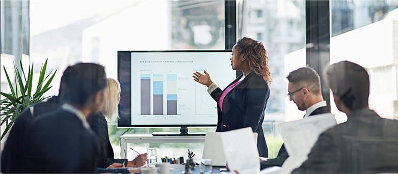 Female financial services consultant presenting data to colleagues