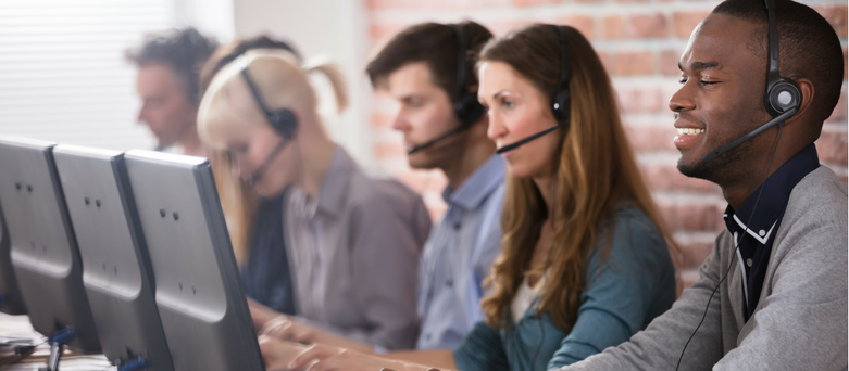 Group of people wearing headsets working in a call centre